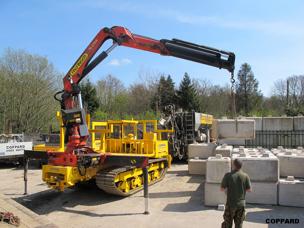 Tracked dumpers with cranes for The crain